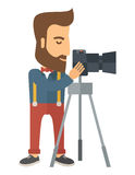 Photographer Standing preparing his camera with. A Photographer Standing preparing his camera with stand to take a picture. A Contemporary style. Vector flat Stock Photos