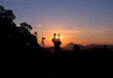 Photographer standing at sunset Royalty Free Stock Photos