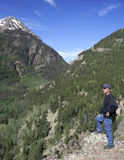 A Photographer Stands on a Mountain Overlook. A Bearded Photographer Stands on a Mountain Overlook Stock Images