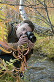 Photographer at a stream Royalty Free Stock Photography