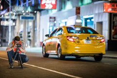 Photographer in the Street of New York taking a long Exposure Pi Stock Images