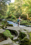 Photographer strid. Skipton, Yorkshire, UK. September 13th 2016 Visitor photographing the famous Strid at the riverr wharfe at Bolton Abbey, Skipton, Yorkshire Royalty Free Stock Images
