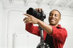 Photographer in studio. Royalty Free Stock Images