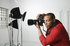 Photographer in studio. royalty free stock photo