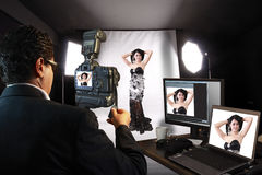 Photographer in Studio with fashion model Stock Photo
