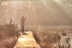 Photographer at sunrise Royalty Free Stock Photography