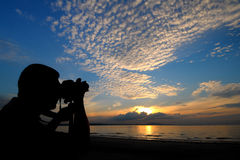 Photographer at sunrise Stock Images