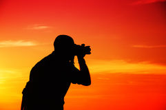 Photographer in sunset Royalty Free Stock Image