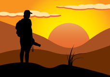 Photographer in sunset. Vector image of a photographer in a landscape Stock Photos
