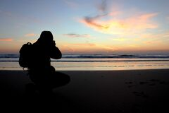 Photographer at sunset royalty free stock image