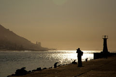 The photographer in Kalk bay, South Africa Royalty Free Stock Photo