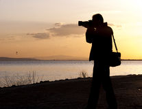 Photographer and sunset Royalty Free Stock Photography