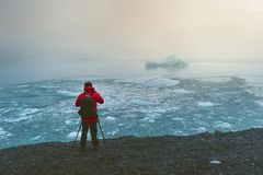 Photographer take a photo at ice in Iceland royalty free stock images