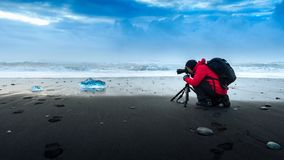 Photographer take a photo at ice in Iceland Royalty Free Stock Photos