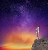 Photographer take a photo in a night sky full of stars Stock Image