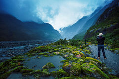 Photographer take a photograph in franz joseft glacier south isl Stock Photos