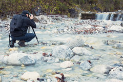 Photographer take a picture of a waterfall Royalty Free Stock Photos