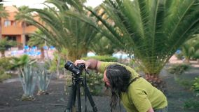 Photographer. Take pictures with camera on a tripod stock video footage
