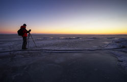 Photographer take pictures on the ice Stock Photography