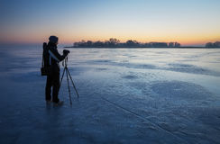 Photographer take pictures on the ice Royalty Free Stock Photography