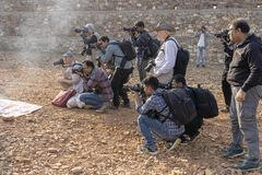 Photographer take pictures at the Pushkar Camel Mela, Pushkar Camel Fair, India. Many photographers from around the world come to royalty free stock photo