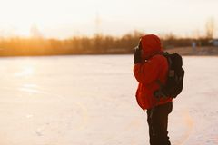 Photographer take pictures on the river bank in winter Royalty Free Stock Images
