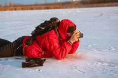 Photographer take pictures on the river bank in winter Stock Photography