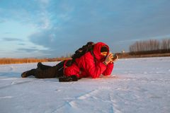 Photographer take pictures on the river bank in winter Stock Images