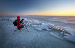 Photographer take pictures in winter Royalty Free Stock Image