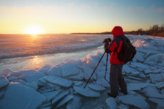 Photographer take pictures in winter Royalty Free Stock Images