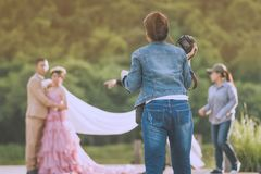 Photographer take pre-wedding photos of the bride and groom in t. He afternoon stock photos