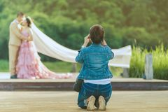 Photographer take pre-wedding photos of the bride and groom in t stock image
