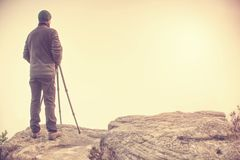 Photographer takes authentic outdoor photos in autumn landscape by big dslr camera. Travel photo lifestyle stock images