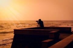 Photographer takes a good shot on the Huahin beach, Prachuap Khi Royalty Free Stock Image