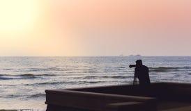 Photographer takes a good shot on the Huahin beach, Prachuap Khi Stock Photo