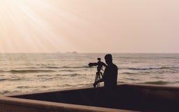 Photographer takes a good shot on the Huahin beach, Prachuap Khi Stock Photos