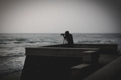 Photographer takes a good shot on the Huahin beach, Prachuap Khi Stock Photography
