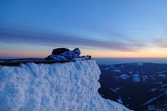 Photographer takes photo of sunset in mountain Royalty Free Stock Image