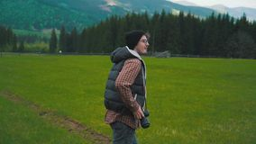 Photographer takes a photo in the valley stock footage