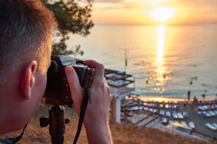 Photographer takes photos of beautiful sunset Royalty Free Stock Image