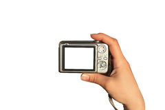 Photographer takes a picture. Palm of hand with digital camera isolated Stock Image