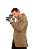 Photographer takes a picture. With medium format camera Royalty Free Stock Images