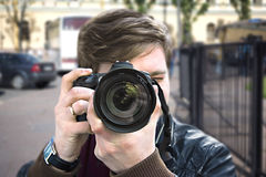Photographer takes a picture. Front view, close-up Royalty Free Stock Photography
