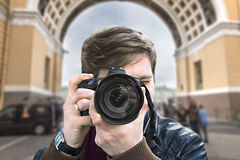 Photographer takes a picture. Front view, close-up Royalty Free Stock Images