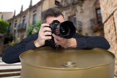 Photographer takes a picture leaning on barrel Stock Photos