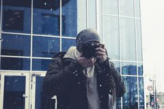Photographer takes picture in mirror downtown Oslo city. stock images