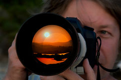 Photographer takes picture of sunset Royalty Free Stock Photography