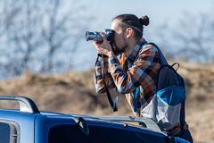 Photographer takes pictures from the car Royalty Free Stock Photo