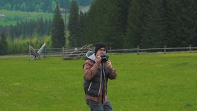 Photographer takes pictures on the go in nature stock footage