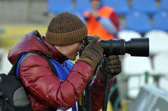 Photographer takes pictures during the match Stock Photo